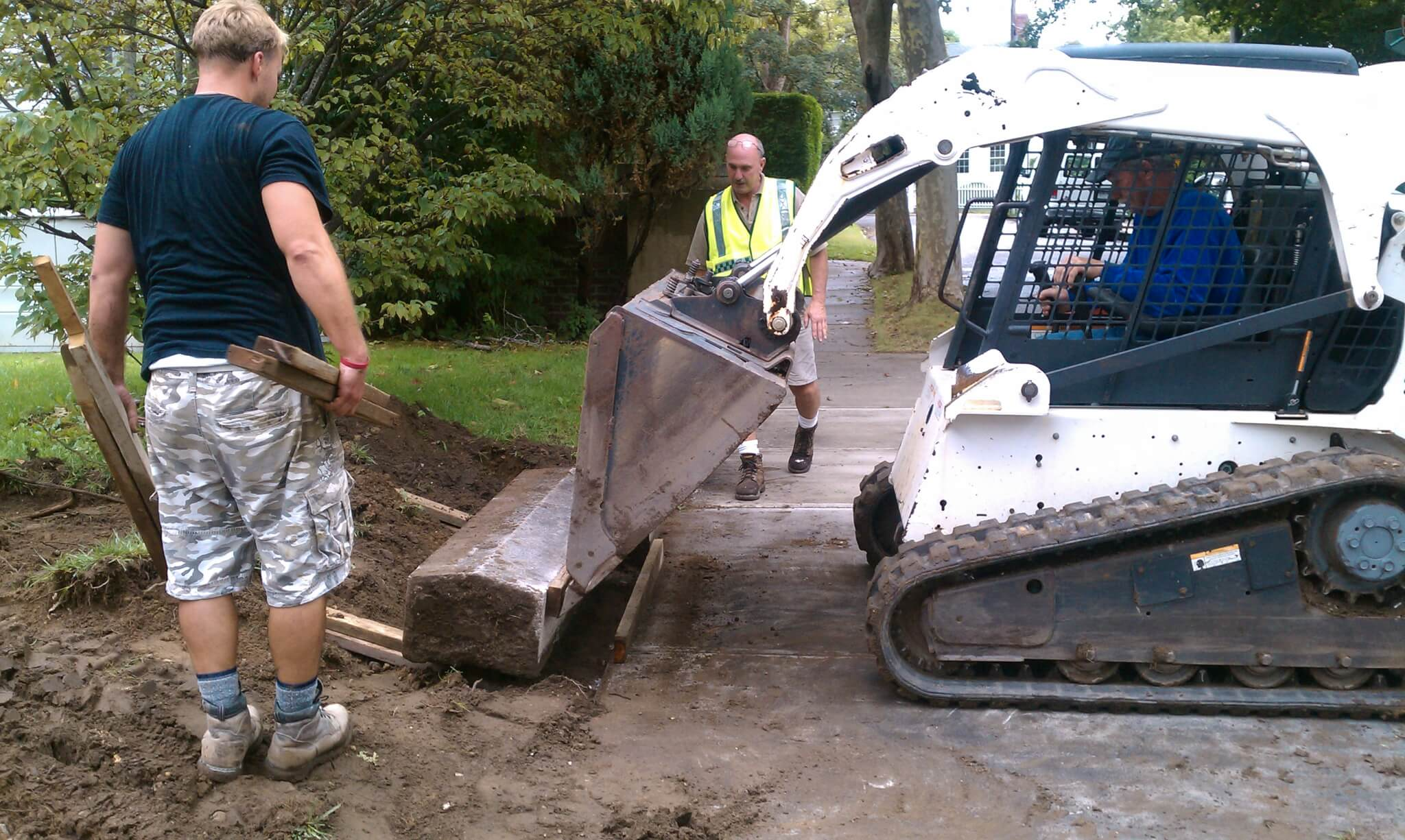 Removing the curbing.