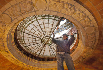 Worker removes panel from laylight in dome of the John Jermain Memorial Library.