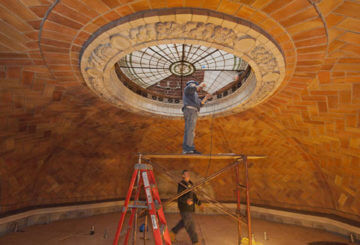 Workers remove panel from laylight in dome of the John Jermain Memorial Library.