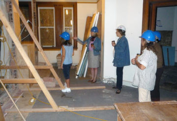 Staff viewing the ongoing preservation work inside the library