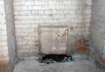 The clean-out door of the library's original coal-fired furnace.