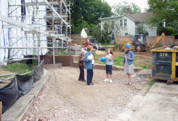 Staff members outside the construction site.
