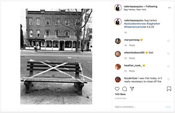 Caption: Sag harbor #policedonotcross #sagharbor #theamericanhotel 4.5.20 [Image is of black and white photograph of taped-off bench on Main Street, across the street from The American Hotel.]