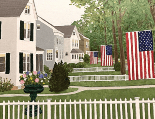 Four houses viewed from the side down a street, all with green lawns and white picket fences all with American flags