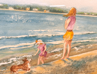 A woman and a young girls on a beach with a small dog.