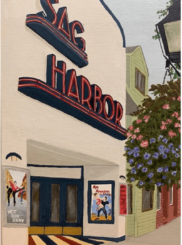 The store front of the historic Sag Harbor Theater with two movie posters and hanging flowers.