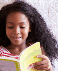 girl reading a book and smiling