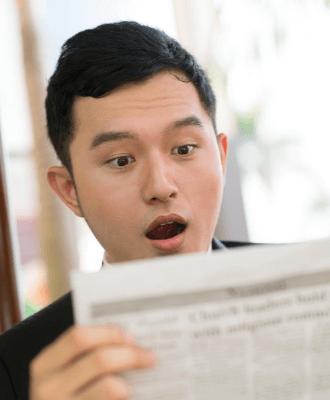 man looking shocked at news
