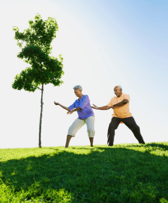 two people doing tai chi