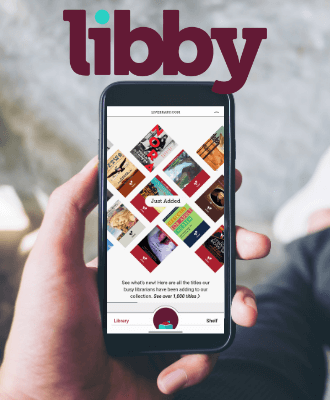 a hand holds a smartphone with the libby app open on the device.