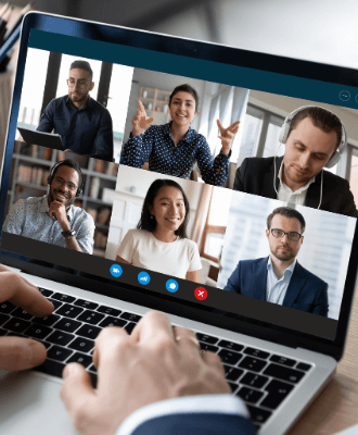 A laptop is open with a video meeting app running showing 6 different adults.
