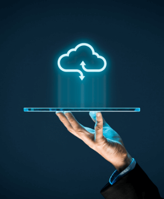A hand holds a laptop, hovering above the laptop is the icon of a cloud.