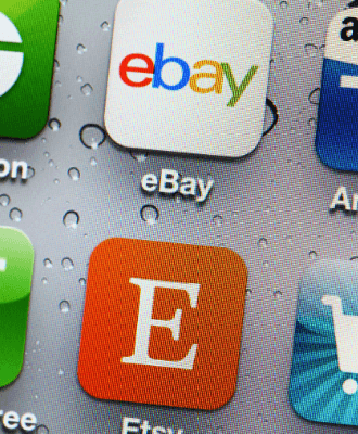 A close up on phone app icons for ebay and etsy.
